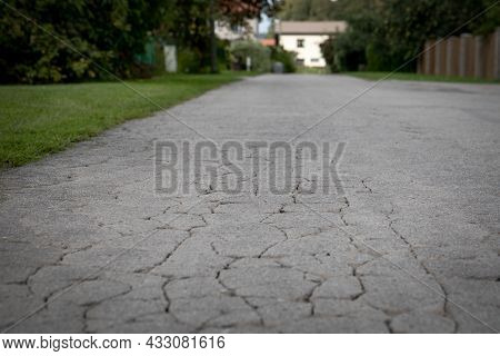 City Street View With Old Cracked Asphalt Pavement