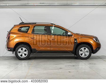 Novosibirsk, Russia - July  08, 2021:  Orange Renault Duster,side View. Popular Car On A Parking