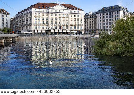 Switzerland, Geneva, August, 2021 - Vintage Stone Building Facade Of The Luxury Five Star Four Seaso