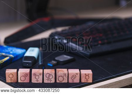 Wooden Dice With Engraved Sexual Orientation Signs.