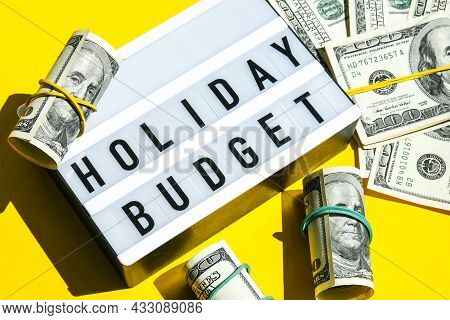 Lightbox Board With Word Holiday Budget On Yellow Background Around Dollar Banknotes. Money, Busines