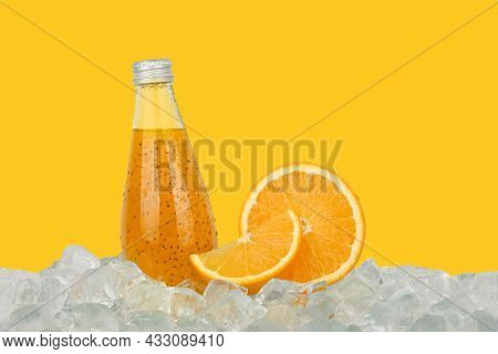 Close Up One Glass Bottle Of Cold Orange Juice Cocktail Drink With Chia Seeds And Half Cut Orange On