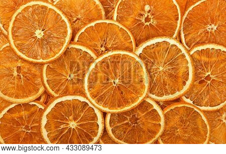 Close Up Many Dried Crispy Orange Ring Chips On Retail Display, Elevated Top View, Directly Above