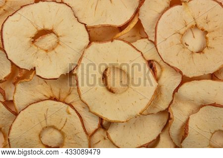 Close Up Many Dried Crispy Apple Ring Chips On Retail Display, Elevated Top View, Directly Above