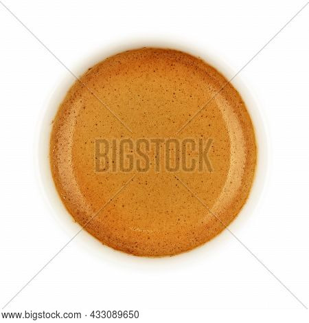 Close Up Espresso Coffee Brown Crema Froth In White Cup Isolated On White Background, Elevated Top V