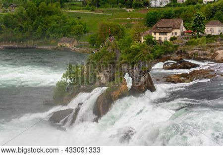 Beautiful View Of Rhine Falls On An Overcast Day. The Biggest Waterfall In Europe At Schaffausen, Sw