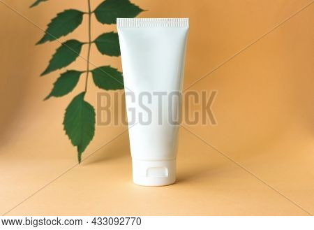 White Tube Of Cream With Green Leaves. Natural Organic Spa Cosmetic Beauty Concept