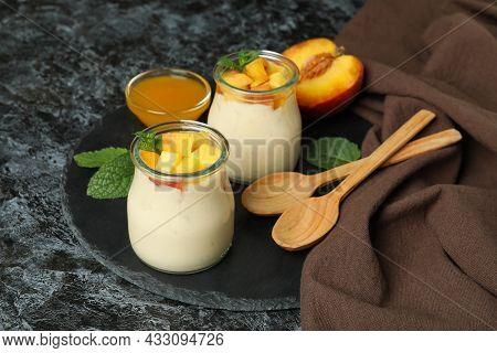 Concept Of Healthy Food With Peach Yogurt On Black Smokey Table