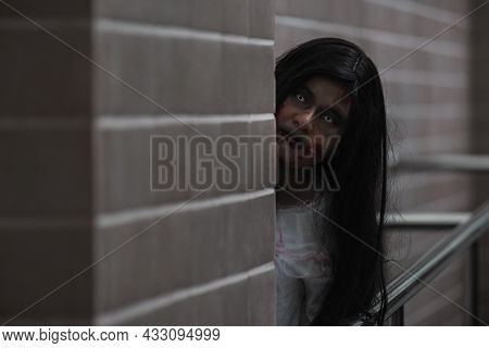 Horror Evil Woman Ghost Creepy In A Dark Room At House. Female Zombie In Blood Devil Is Scary She Ha