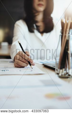 Focus Woman Holding A Pencil Auditors Use Budget Document Calculators To Find Annual Budget Disburse