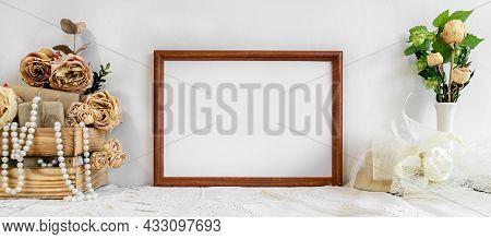 Fashionable White Stock Background With A Blank Photo Frame, Women's Jewelry And Flowers. Blank For