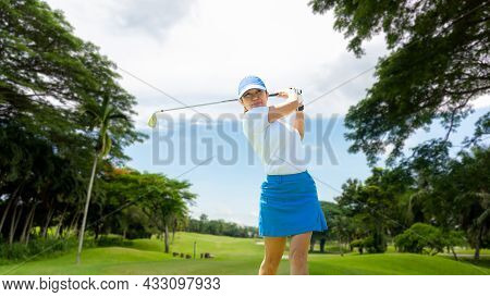 Golfer Sport Course Golf Ball Fairway. People Lifestyle Woman Playing Game Golf Tee Of Blue Sky Back