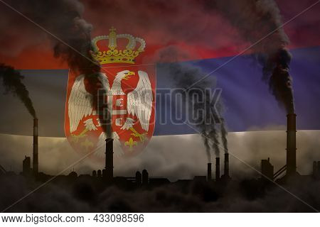 Global Warming Concept - Heavy Smoke From Plant Chimneys On Serbia Flag Background With Space For Yo