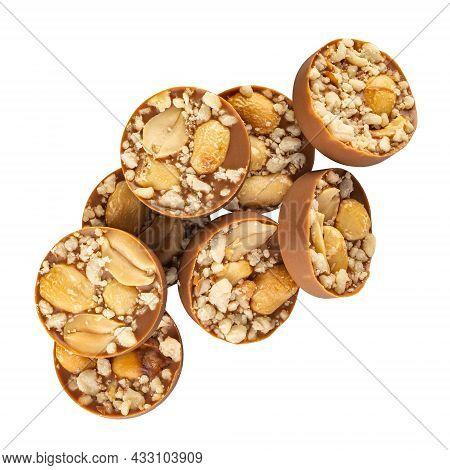 Milk Chocolate Praline With Hazelnut Crumb Topping On White Background