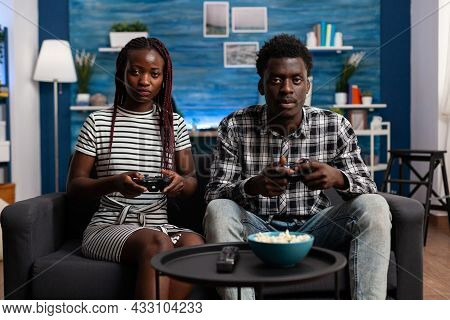 African American Couple Playing Video Game On Tv Console Using Joysticks At Television Display. Blac
