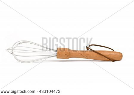 Whisk With Wooden Handle And White Painted Steel On White Background