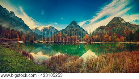 Jasna Lake With Beautiful Reflections Of The Mountains. Triglav National Park, Slovenia. Panoramic V