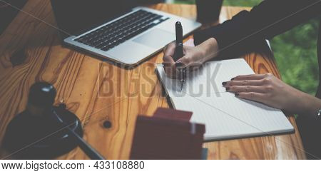 Business Woman Or Legal Advisor Writting In Book On Wooden Desk In Office. Law, Legal Services, Advi