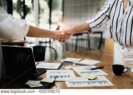 Business Woman Handshake For The New Agreement After Sign In Agreement Contract With Work Together.