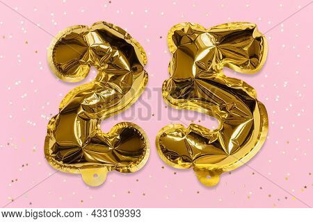 The Number Of The Balloon Made Of Golden Foil, The Number Twenty-five On A Pink Background With Sequ
