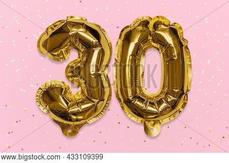 The Number Of The Balloon Made Of Golden Foil, The Number Thirty On A Pink Background With Sequins.