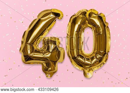 The Number Of The Balloon Made Of Golden Foil, The Number Forty On A Pink Background With Sequins. B