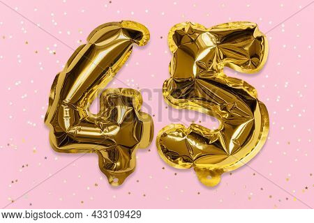 The Number Of The Balloon Made Of Golden Foil, The Number Forty-five On A Pink Background With Sequi
