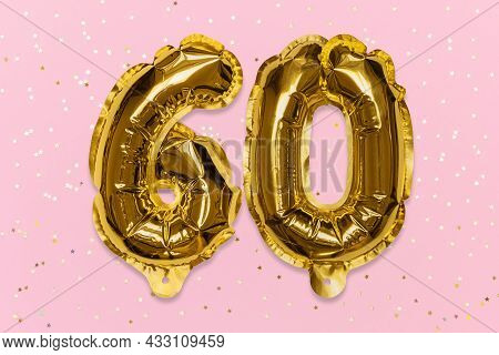 The Number Of The Balloon Made Of Golden Foil, The Number Sixty On A Pink Background With Sequins. B