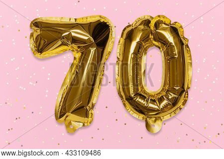 The Number Of The Balloon Made Of Golden Foil, The Number Seventy On A Pink Background With Sequins.
