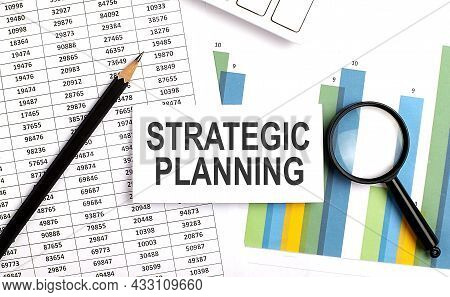 Strategic Planning Text On White Card On Chart Background