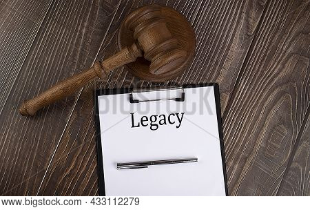 Legacy Text On Paper With Gavel On Wooden Background