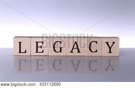 Legacy Concept, Wooden Word Block On Grey Background