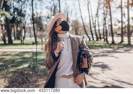 Stylish Woman In Reusable Mask Enjoys Sun And Fresh Air Outdoors During Coronavirus Covid-19 Pandemi