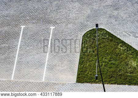 Empty Parking In The Courtyard Of A House With White Markings On Paving Stones Or Paving Slabs. View