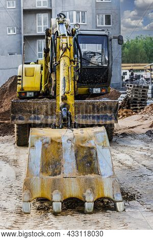A Heavy Crawler Excavator With A Large Bucket Is Getting Ready For Work. Heavy Construction Equipmen