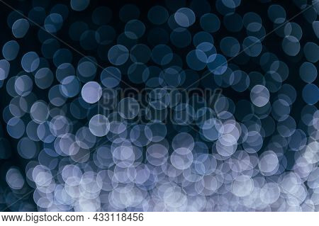 White Abstract Bokeh Made From Christmas Lights On Black Isolated Background. Holiday Concept, Blur
