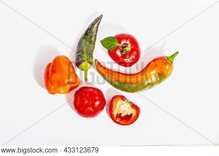 Ripe Multicolored Peppers Isolated On White Background