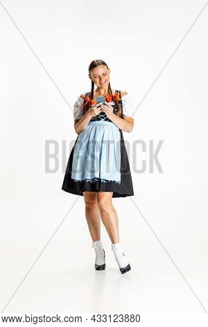 Full-length Portrait Of Beautiful Woman, Waitress In Traditional Austrian Or Bavarian Costume Standi