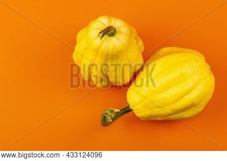 Ripe Yellow Pumpkins Isolated On Bright Orange Background