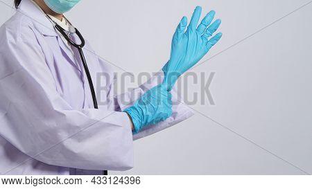 Wearing Gloves. Asian Doctor Wear Blue Rubber Nitrile Hands Glove.