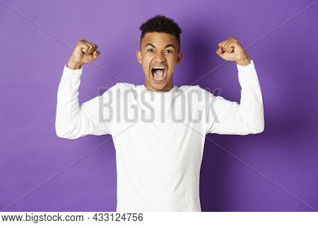 Image Of Encouraged African-american Guy, Shouting And Looking Determined, Winning Something, Achiev