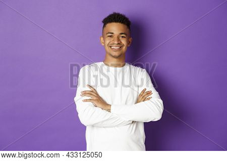 Image Of Confident African-american Man, Cross Arms On Chest And Smiling With Self-assured Expressio