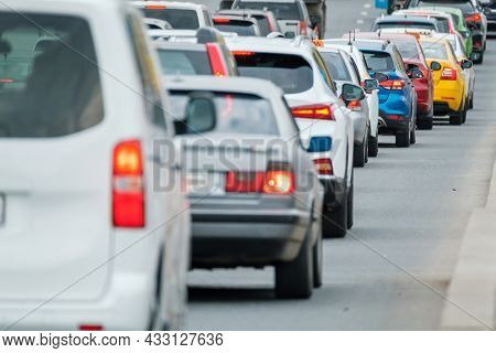 Traffic jam on multi-lane road in big city center downtown, day time