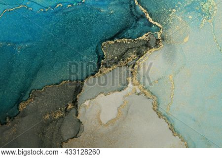 Art Abstract painting blots horizontal background. Alcohol ink black, blue and gold colors. Marble texture.