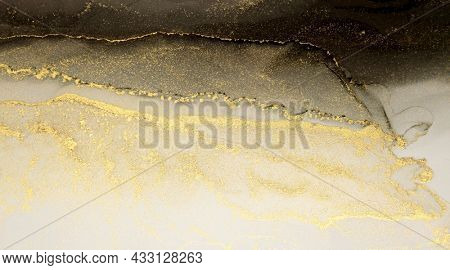 Abstract watercolor black and gold glitter color horizontal background. Marble texture. Alcohol ink colors.