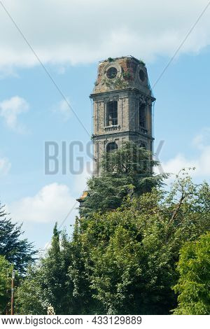 Old Tower Of Cambron Abbey At Pairi Daiza, Belgium Against Blue Sky