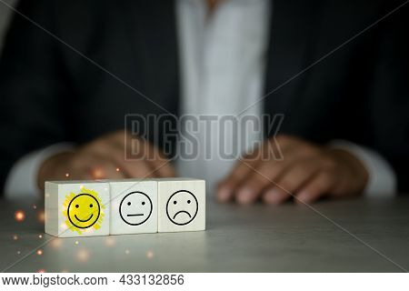 Wooden Blocks With The Face Symbol On The Table With Businessman In Black Suit Background, Satisfact