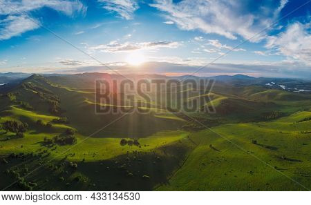 Aerial Panorama drone shot of beauty dawn on the peak, in the mountains in Altay, summertime
