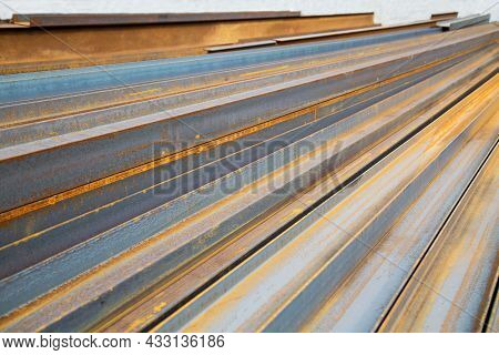 The Channel Is Blue Metal With Traces Of Rust, Stacked In A Stack. Construction Production Technolog