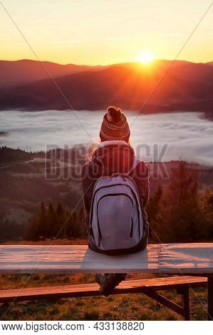 Woman Meets Sunrise In The Autumn Mountain. Soul Morning With Beautiful Foggy Landscape